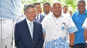 Chinese Ambassador Qian Bo and Fiji PM Voreqe Bainimarama.